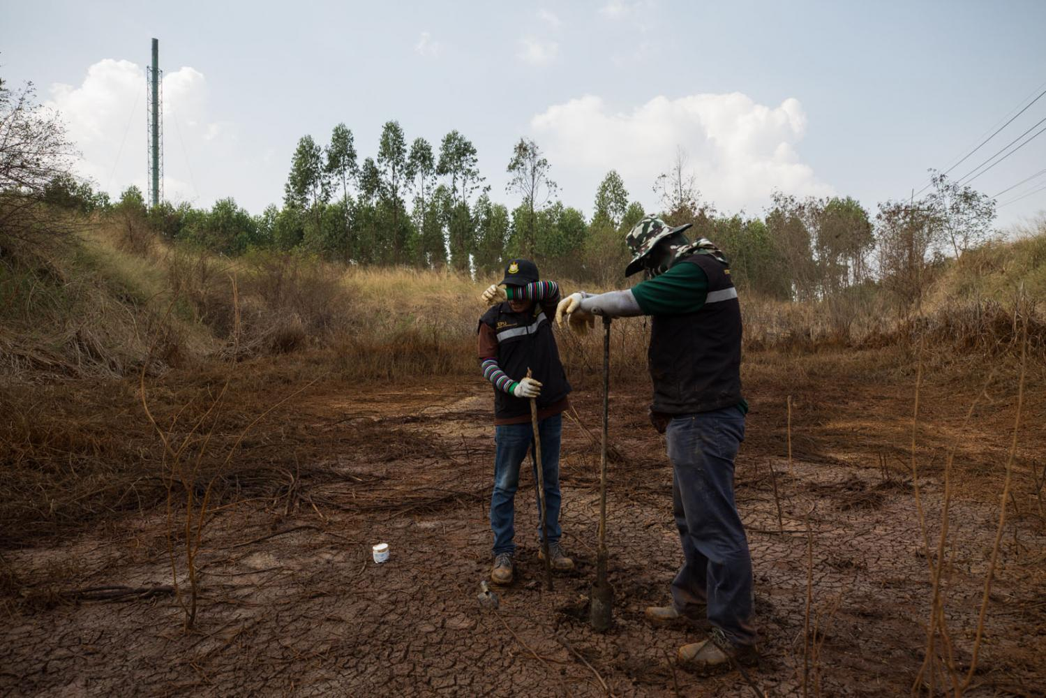 The Thai Environmental Agency collects soil samples at a polluted site to find out where the polluting comes from. Chachoegnsao, Thailand.
