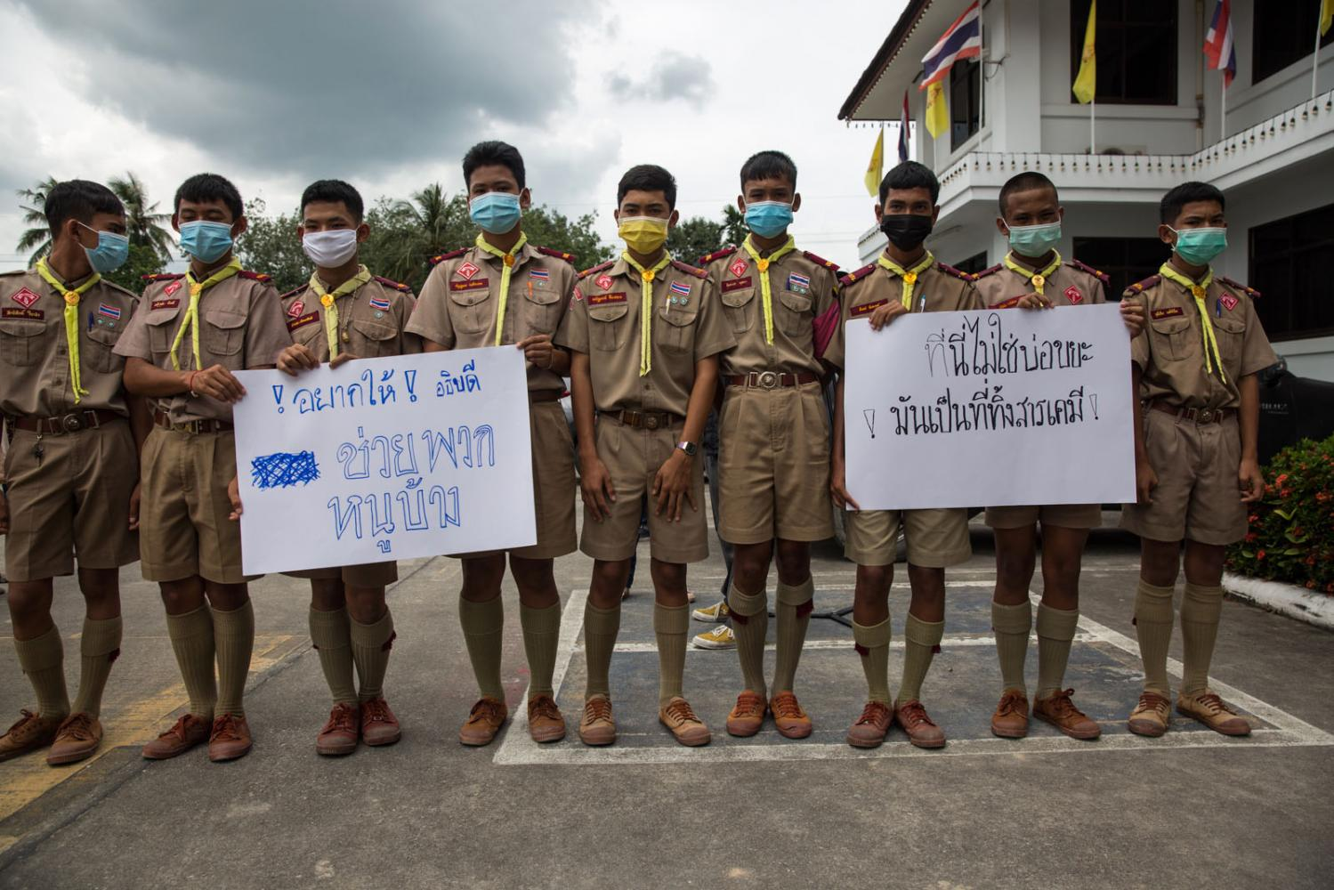 Thai boy scouts join in an anti-recycling factory protest. Rayong, Thailand.