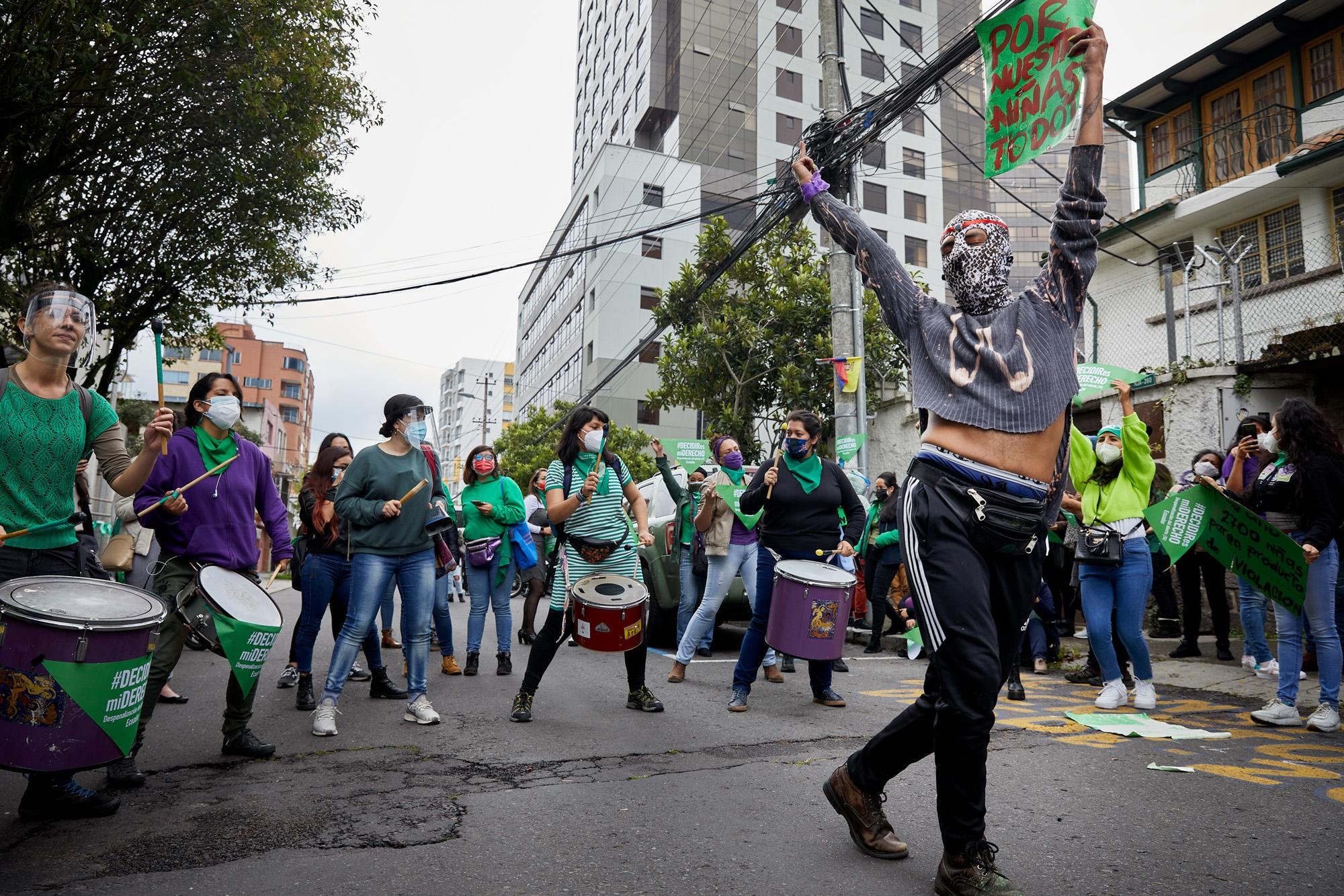 Women and trans people dance reggaeton while waiting for the Constitutional Court ruling on decriminalization of abortion for rape, in the back anti-rights groups pray loudly.