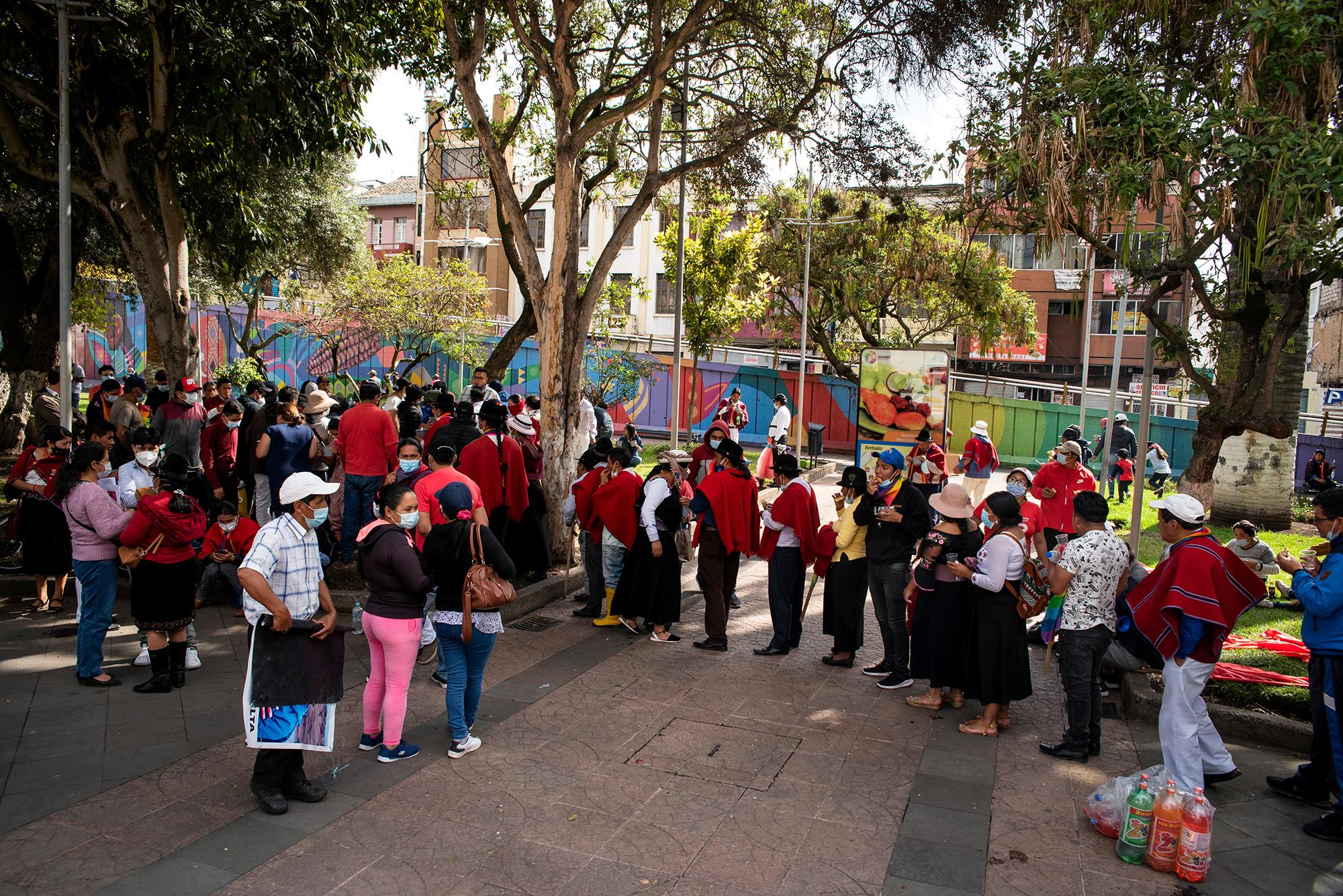 Participants of the National March for Democracy are lining up to receive the lunch on the afternoon of February 21 at Parque 12 de Noviembre in Ambato, Ecuador. During the march, they have community meals, where several participants prepare and provide food to their partners. Johis Alarcón for The New York Times.