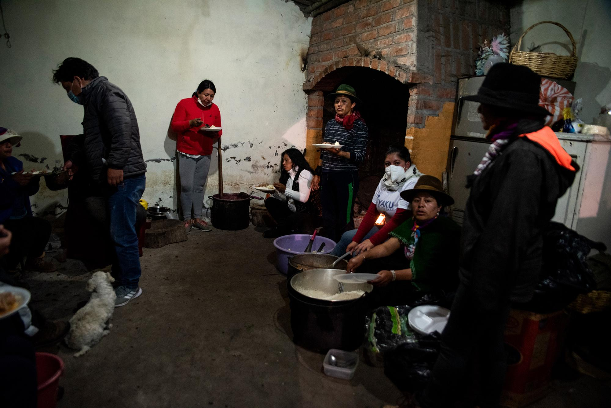 Indigenous women of Tungurahua serve dinner to the participants of the National March for Democracy on the night of February 21, 2021. Each community receives the participants and provides them with food and lodging. Tungurahua, Ecuador. Johis Alarcón for The New York Times.
