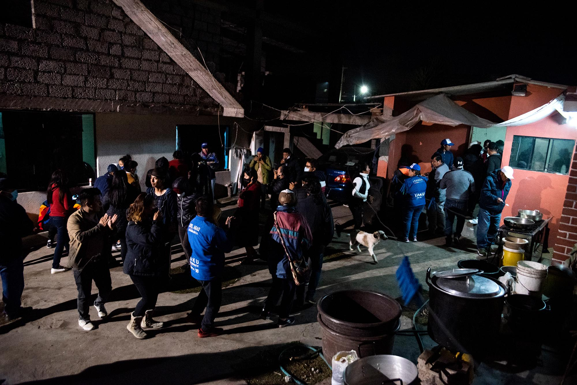 Participants of the National March for Democracy share a cultural night with food and music to celebrate their arrival in Tungurahua on the night of February 21, 2021.Tungurahua, Ecuador. Johis Alarcón for The New York Times.