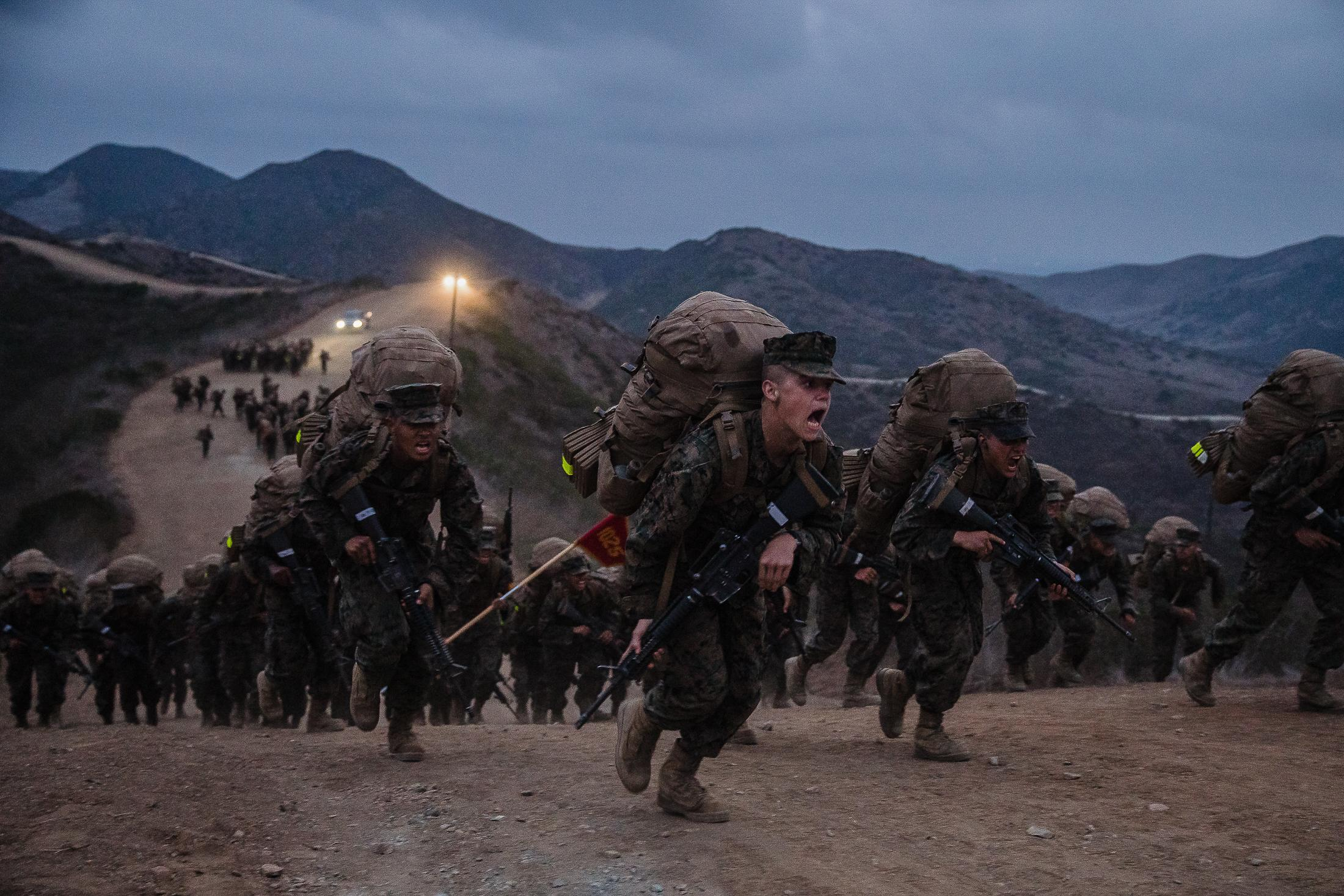 Recruits run up to the top of the last hill during the Crucible at Camp Pendleton North in San Diego County on October 8, 2020.
