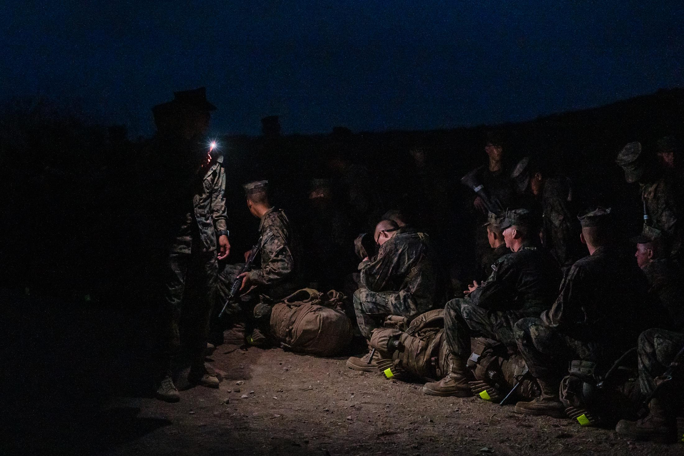Early morning recruits wait for the rest of the men so they can make their way up one last hill during the three day crucible at Camp Pendleton North in San Diego County, California on October 8, 2020.