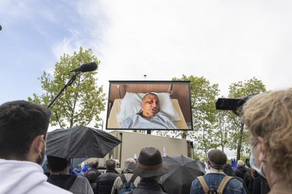 Testimony of a policeman injured in Rive de Gier, on a giant screen during the citizen's rally, an inter-union demonstration of police officers such as Alliance Police Nationale, UNSAP, SGP etc., to denounce the laxity of justice and to pay tribute to all police officers injured or killed on duty, in front of the National Assembly, in Paris, on May 19, 2021. Antoine Wdo / Hans Lucas Temoignage d un policier blesse a Rive de Gier, sur ecrang geant lors du rassemblement citoyen, manifestation citoyenne inter syndicale des policiers comme Alliance Police Nationale, UNSAP, SGP etc, pour denoncer le laxisme de la justice et en hommage a tous les policiers blesses ou tues en fonction, devant l' Assemblee nationale, a Paris, le 19 mai 2021. Antoine Wdo / Hans Lucas