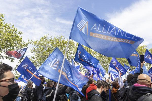Police officers holding flags of the Alliance police Nationale union during the citizen rally, inter-union demonstration of police officers such as Alliance Police Nationale, UNSAP, SGP etc, to denounce the laxity of justice and in tribute to all police officers injured or killed on duty, in front of the National Assembly, in Paris, May 19, 2021. Antoine Wdo / Hans Lucas Des policiers tenant des drapeaux du syndicat Alliance police Nationale lors du rassemblement citoyen, manifestation citoyenne inter syndicale des policiers comme Alliance Police Nationale, UNSAP, SGP etc, pour denoncer le laxisme de la justice et en hommage a tous les policiers blesses ou tues en fonction, devant l' Assemblee nationale, a Paris, le 19 mai 2021. Antoine Wdo / Hans Lucas