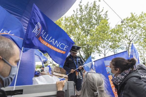 Child dressed as a policeman holding a police alliance flag during the citizen's rally, inter-union demonstration of police officers such as Alliance Police Nationale, UNSAP, SGP etc., to denounce the laxity of justice and in homage to all police officers injured or killed on duty, in front of the National Assembly, in Paris, May 19, 2021. Antoine Wdo / Hans Lucas Enfant deguise en policier tenant un drapeau alliance police lors du rassemblement citoyen, manifestation citoyenne inter syndicale des policiers comme Alliance Police Nationale, UNSAP, SGP etc, pour denoncer le laxisme de la justice et en hommage a tous les policiers blesses ou tues en fonction, devant l' Assemblee nationale, a Paris, le 19 mai 2021. Antoine Wdo / Hans Lucas