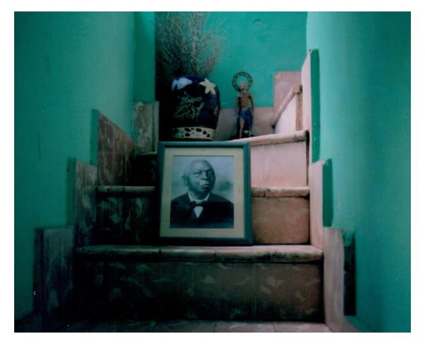 This archive photo of Remigio Herrera lies in the home of Juan Lozano Gomes, curator of the museum of Regla. Herrera, a former slave  of Yoruba origin, was a pioneer in Ifa religion in Cuba. When they were disembarked of slave ships, deported Africans had to take the name of their 'owner' and were forced to abandon their faith. Keeping and transmitting an African faith was a form of cultural  resistance. Havana, Cuba © Laeïla Adjovi