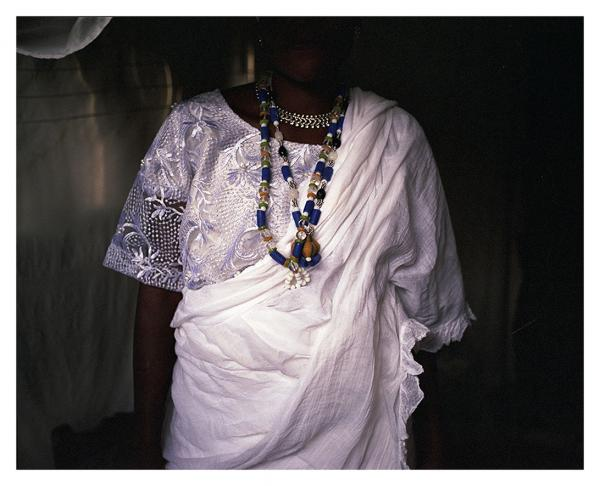 On both sides of the ocean, beads are important part of the religious practice. Denandi Yehouessi, a priestess of Mamiwata, is wearing her sacred beads before a ritual ceremony at the beach. Mamiwata ( mother of water) is another avatar of the deity of the ocean, with a name clearly originating from the contact between indigenous people of the West African coast and British sailors. Ouidah, Bénin © Laeïla Adjovi