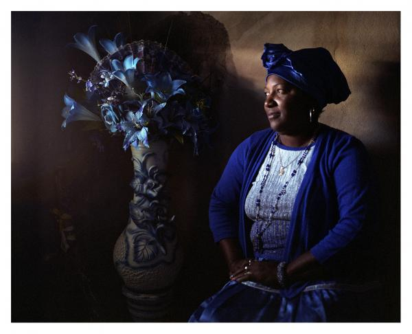 """Yamilka de la Caridad Cejas Molinet is a Cuban daughter of Yemaya. She has a syncretic spirituality that blends Catholicism, Regla de Ocha, and Regla palo Monte. But above all, she is an adept of spiritism, the practice that summons the spirits of the dead to communicate with them. """" Antes del santo son los muertos'  she claims.  « The deads come before the deities ». The worship of ancestors is an essential part of African and Afro-Caribbean spiritualities. Agramonte, Cuba © Laeïla Adjovi."""