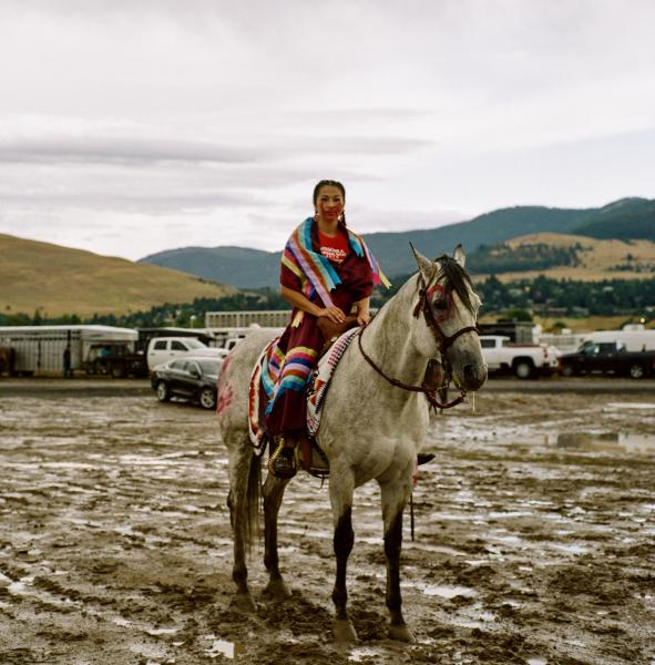 Kiana Simonson rides on horseback to raise awareness about missing and murdered Indigenous women and girls in Missoula, Montana during the state fair in August 2019. Native American women and girls are targeted at rates far higher than other American women and in some communities are ten times more likely to be murdered. Copyright © Sara Hylton/Redux Pictures, 2019