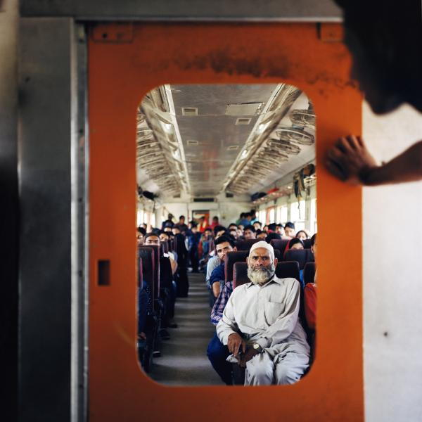 An old Kashmiri man travels by train departing from Baramulla at the beginning of the train line in Northwestern Kashmir, headed towards the capital, Srinagar. This was during a relatively stable day in the valley. Two days later, militant Burhan Wani of Hizbul Mujahideen was killed by Indian security forces and the entire region spiralled into protests and violence, the valley was shutdown for months and trains were inoperable. Copyright © Sara Hylton/Redux Pictures, 2016