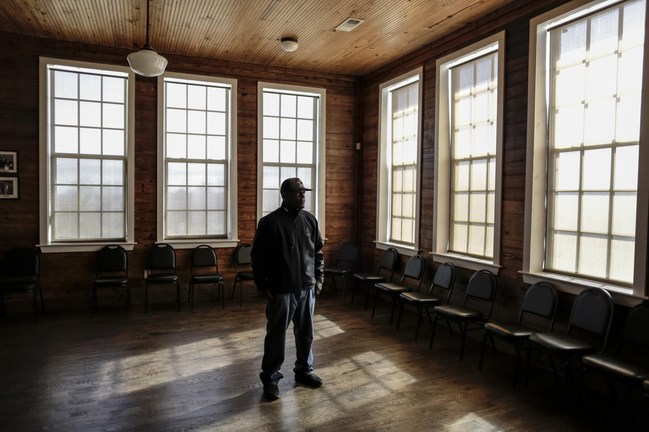 Tony Crawford stands in at the Mount Pleasant Colored School in Weatherford after a meeting with city officials about the Confederate Statue's future. The Colored School was built in 1907 for black children to get an education. Many of Tony's elders attended this school and spoke of the abuse and segregation in the city.