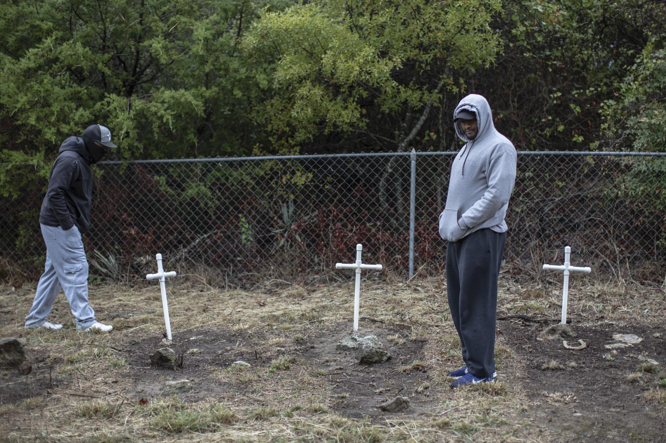 Anthony Crawford (Left) and James Gray (Right) walk the newly discovered cemetery discovered by a caretaker of the property currently being excavated for development. Both brothers are local Weatherford activists fighting to find the slave trade history in their hometown and protest and organize against a Confederate statue at the Weatherford Courthouse, which the United Confederate Daughters placed.