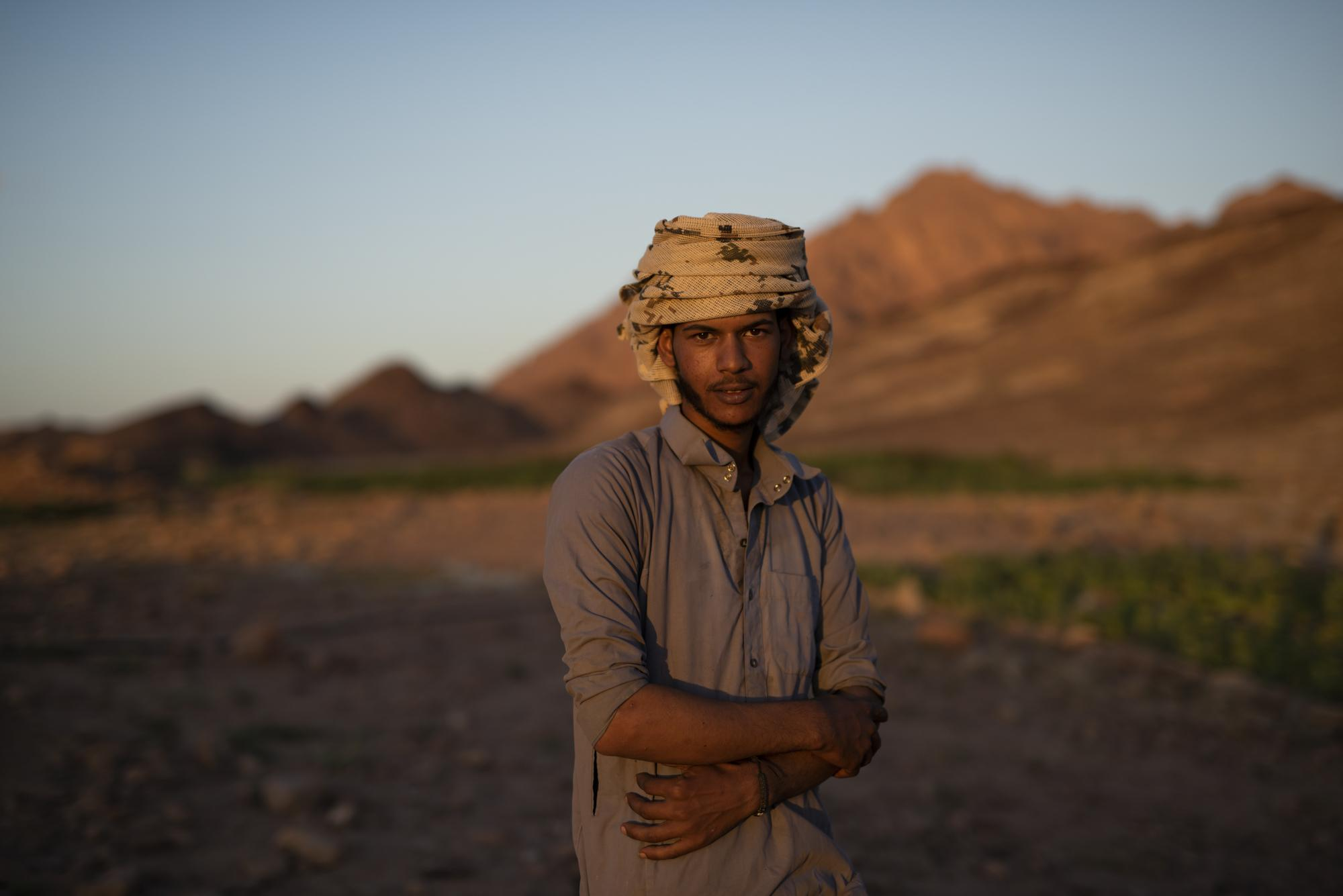 Youssef (20), collects Khodary plant leaves in order to be then grind the next day and dried up before selling to merchants and customers. Youssef has taken over an old Bedouin tradition to grow and care for his family garden. A tradition that has disappeared for years before the return of the flood to the land in March 2020. Gharba Valley, S.t Catherine, South Sinai, Egypt, October 2020.