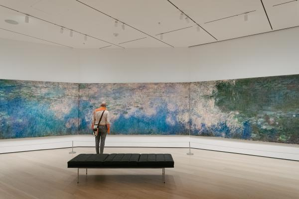 Museum goer in front of Monet's Water Lillies at the Museum of Modern Art