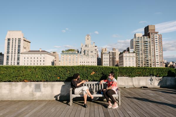 Two women enjoying the sun at the Roof Garden at the Metropolitan Museum of Art