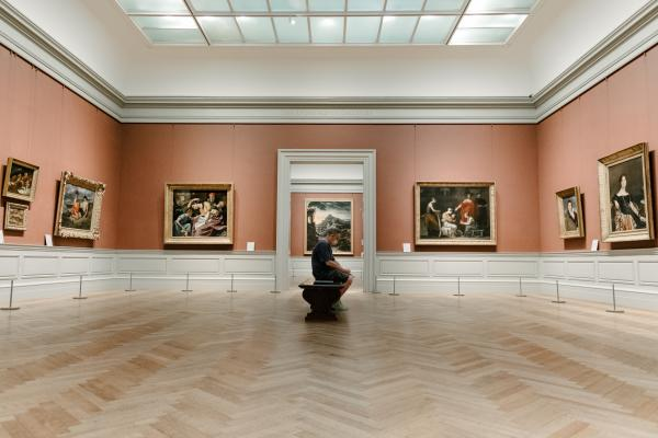 A man sitting alone in the impressionist gallery
