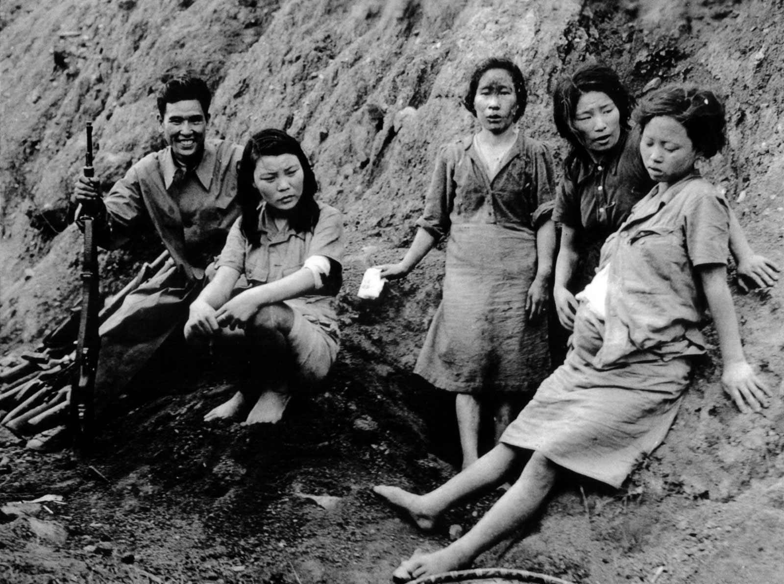Chinese soldier with Korean 'comfort women' after they were liberated by US-China Allied Forces, Songshan, Yunnan Province, China. September 3, 1944 Photo by Charles H. Hatfield, U.S. 164th Signal Photo Company, US National Archives