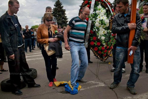Residents who support Russia stamp on the Ukrainian flag, during the funeral of Yulia Izotova, a 21-year-old nurse who was killed in fighting between pro-Russian protesters and the Ukrainian military, in Kramatorsk, Ukraine.