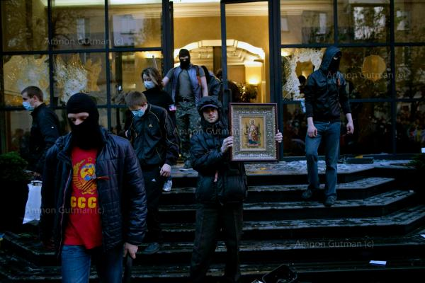 Pro-Russian activists looting the offices of Industrial Union of Donbass Corporation in Donetsk.