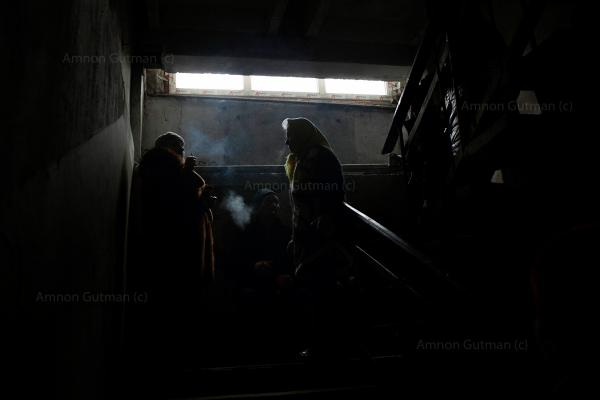 Residents of Debaltseve waiting in an underground shelter to get food from local NGO. Debaltseve was a scene of heavy fighting between UA army and DPR forces, eventually it fell to DPR hands.