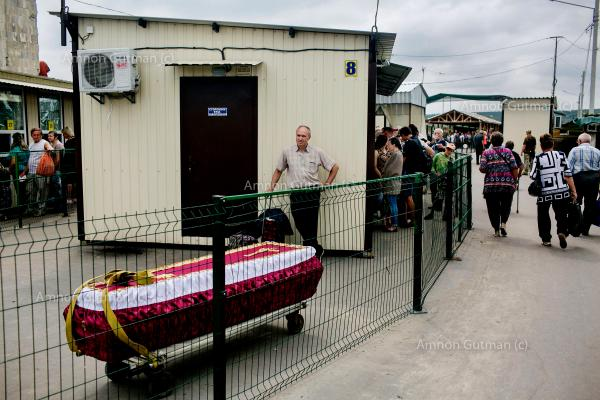 A coffin of a civilian who passed away in LPR (Luhansk People's Republic) territory, being transported to the Ukrainian side of the border, in order to be buried there. Stanitsia Luhanskia crossing check point. one of the border crossing between the two sides.