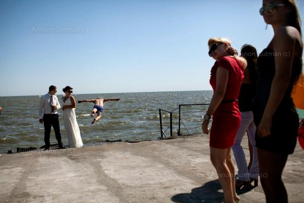 Residents of the city of Mariupol celebrating a wedding at the beach, the city was the scene of heavy fighting between Donetsk people's militia and UA army, and for now is being controlled by the UA army,