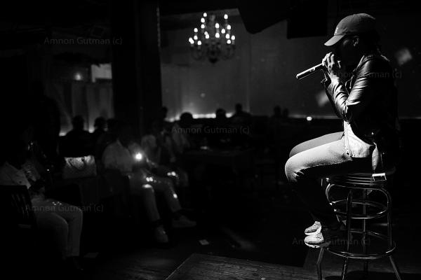 Mani The Mogul, a hiphop artist who also works with ManUp in East New York, performing in Fine Spot pub,Clinton Hills, Brooklyn NY.