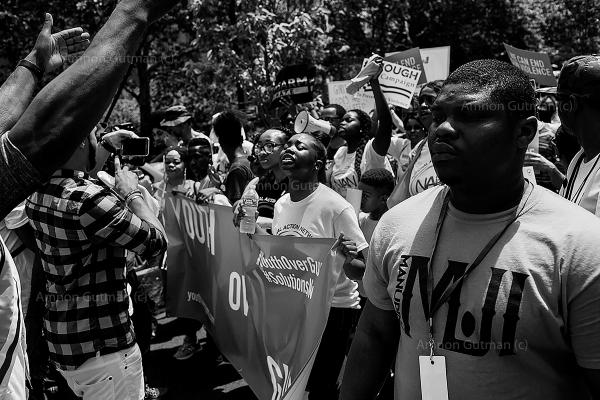 Brother Tivon (R-23)of ManUp Alpha cure violence team, during a peace march over the Brooklyn Bridge. The march marks the beginning of gun violence awareness month (June) in NY.