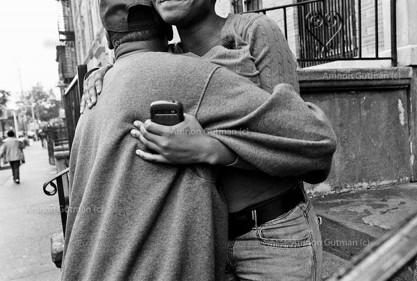 """Chris, an S.O.S program participant who found a job, and """"got out"""" of the streets, hugs his girlfriend in the neighbourhood of Crown Heights."""