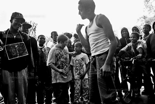 A gathering of Young boys during the S.O.S Peace Games, part of S.O.S peace week. Crown Heights.
