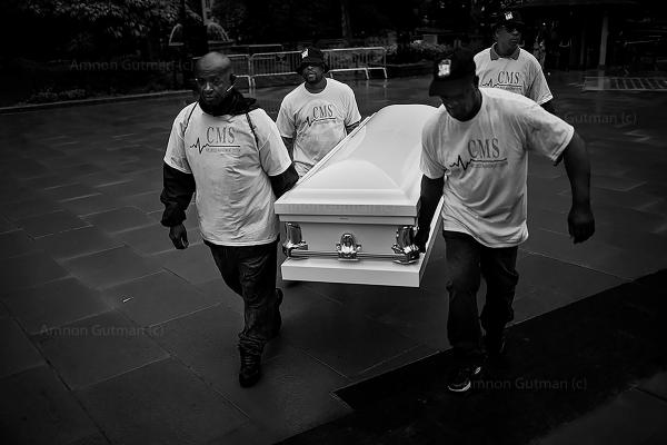 Members of different Cure Violence teams in NY, carry a white empty coffin , to the press conference in city hall NYC, that marks the beginning of gun violence awareness month in NY.