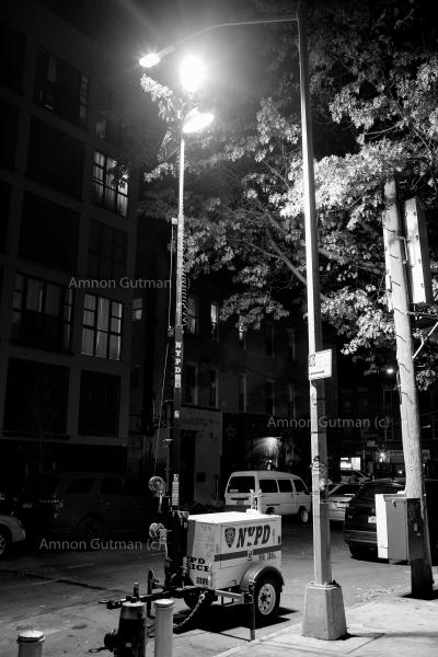 Night Lighting used by the NYPD , in some areas of Brooklyn, in order to help NYPD officers operate during night time. H Block, Flatbush, Brooklyn, A drive-by shooting that happened a few weeks before in that location, left Theodore Llyod Senior, a twenty three years old male dead and five others injured. No arrests have been made, the investigation is ongoing....