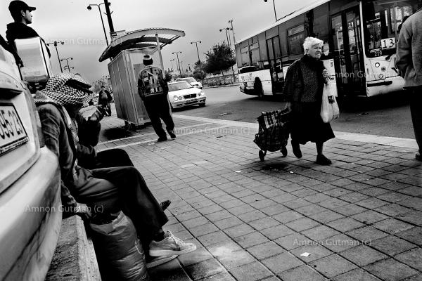 Palestinian men who stay and work illegally in Israel waiting for contractors to come and pick them up, Beer-Sheva city, Israel.