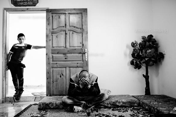 Two brothers from Ar Ramadin tribe in their home. Their family had a vegetable stand in the entrance to the village- it was destroyed by Israeli border police, who claimed it was illegal.
