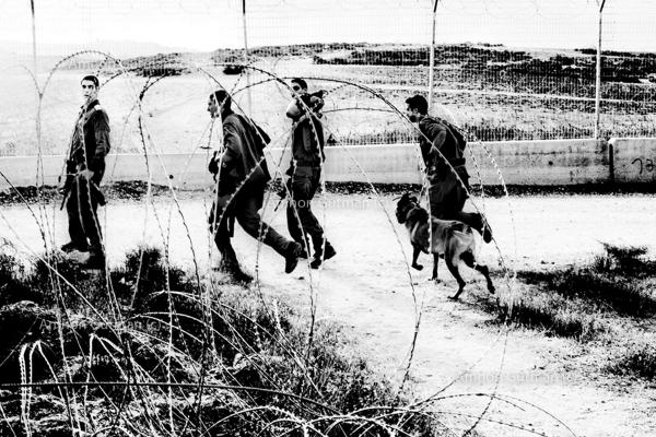 IDF soldiers patrol what used to be the 1967 border line fence. South Mt Hebron, Israel. The 5 kilometres area of the fence just outside the Ar Ramadin village is notoriously easy to slip through from the West Bank into Israel.