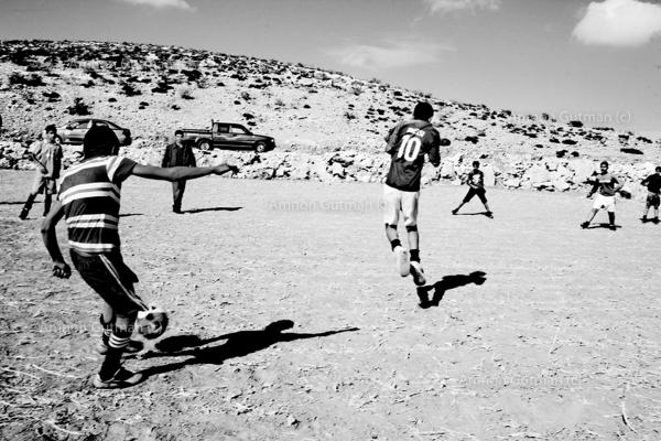 Bedouin children playing, at the village main football field. Ar Ramadin village. South Mt Hebron, West Bank.