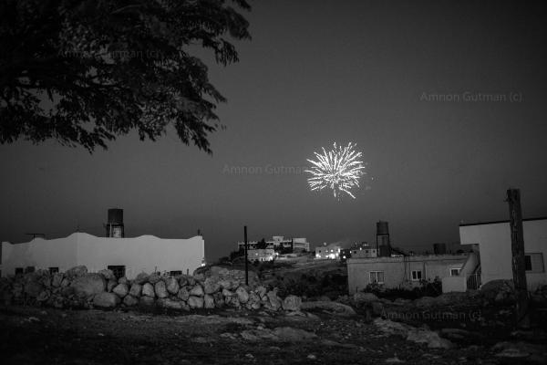 Fireworks shot into the air, during a wedding celebration, in Ar Ramadin village.
