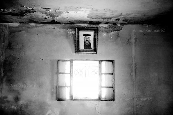 An Ar Ramadin tribe elder picture hangs on the wall in his family living room. Ar Ramadin Village, South. Mt. Hebron, West Bank. The 5 kilometres area of what used to be the 1967 border line fence just outside the village is notoriously easy to slip through from the West Bank into Israel.