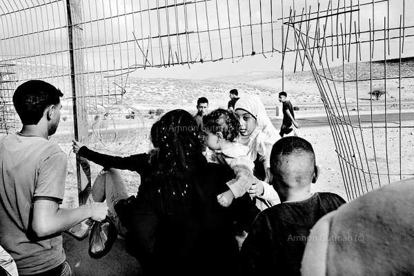 A Palestinian family cross illigaly into Israel, via a gap in what used to be the 1967 border line fence. Ar Ramadin Village, S Mt Hebron, West Bank. The 5 kilometres area of just outside the village is notoriously easy to slip through from the West Bank into Israel.