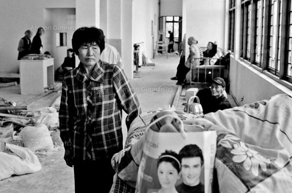 Residents of Mianyang rural areas, waiting in a higher ground shelter. the. Tangjiashan quake lake posed a series flood risk to people living downstream in Mianyang area.