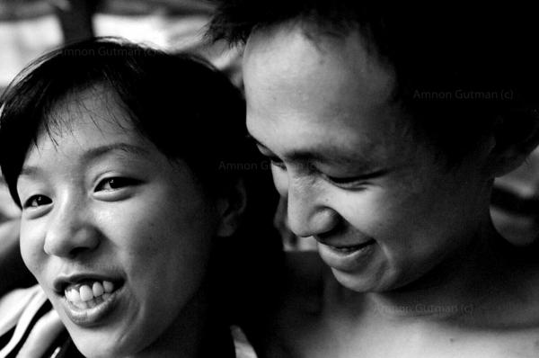 Brother and sister at the family shelter, living outside their destroyed home . Yingxiu town, Sichuan province.