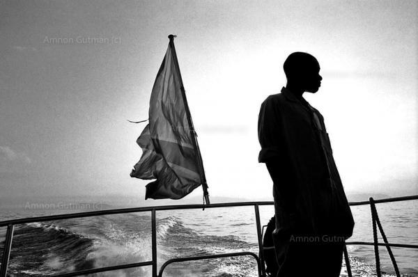 A young boy on a boat sailing from Goma (north Kivu) to Bukavu (South Kivu), lake Kivu.
