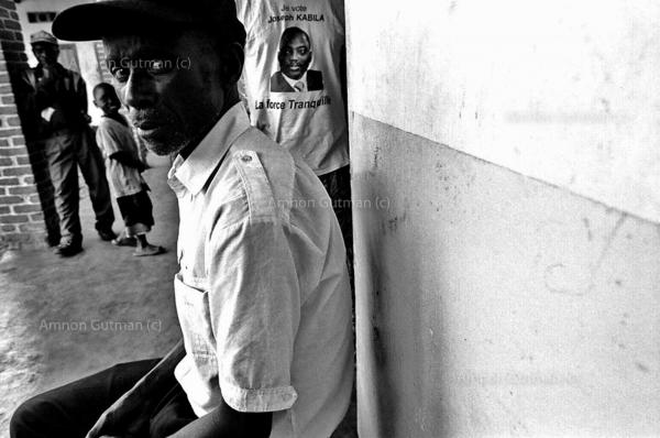 Family member of patients at the place for the mentally insane- Cante Mental hospital, waiting for their visit time to begin, Goma, North Kivu.