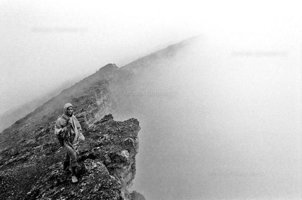 A local national park ranger, standing on peak of Mt Nyiragongo volcano Virunga national park, North Kivu.