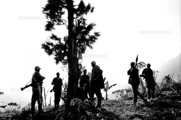 Young FDLR Hutu militia soldiers, getting ready to go out on patrol near their camp, Kilungutwe , South Kivu.