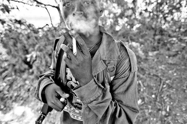 A young FDLR Hutu militia soldier, during a patrol near his camp , Kilungutwe, South Kivu.