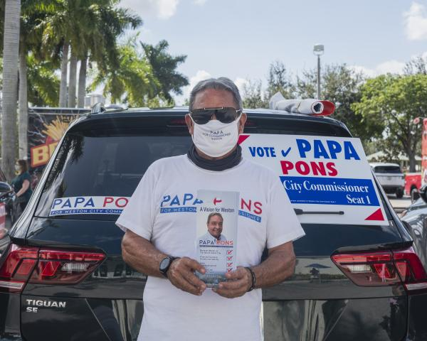 Weston, Fl – October 29, 2020: Papa Pons; Weston resident running for City Commisioner of Weston. He is campaining outside of the Broward County Library Weston Branch - an early voting location. Credit: Andres Guerrero