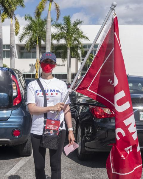 Weston, Fl – October 29, 2020: Weston resident showing support for Donald Trump at the Broward County Library Weston Branch - an early voting location. Credit: Andres Guerrero